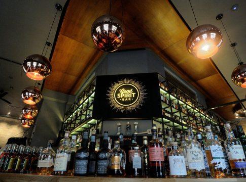 Good Spirit bar with various spirits in front.