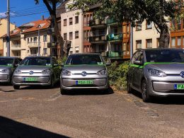 A few Volkswagen e-Up!s parked diagonally.