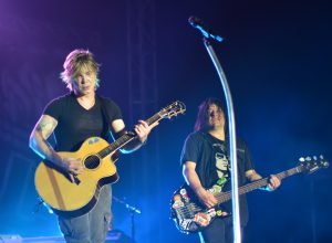 The Goo Goo Dolls in concert playing guitar